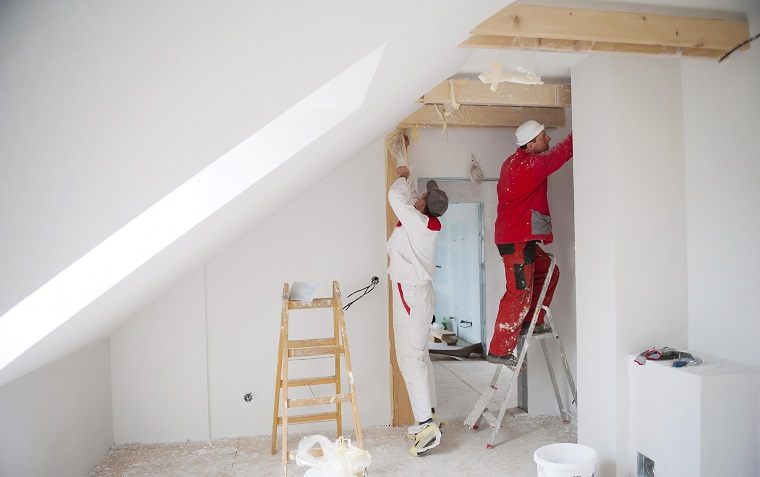 Tradesmen working on a room